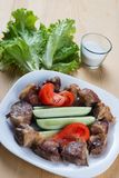 Meat kebab, pork balls on white plate with fresh tomato Royalty Free Stock Photography
