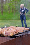 Meat kebabs cooking over a summer BBQ Stock Photography