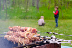 Meat kebabs piled at the side of s barbecue Stock Photography
