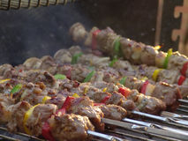 Meat kebabs shashlyk summer bb. Meat kebabs shashlyk with color peppers and mushrooms on a summer barbecue Stock Photos