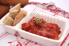 Meat with ketchup. Some fresh meat with ketchup and bread Stock Image