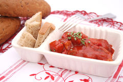 Meat with ketchup. Some fresh meat with ketchup and bread Royalty Free Stock Images