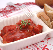 Meat with ketchup. Some fresh meat with ketchup royalty free stock photos