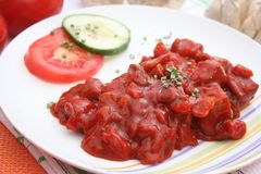 Meat with ketchup. Some fresh meat with ketchup royalty free stock image