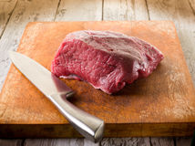 Meat with knife Stock Images