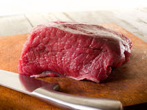 Meat with knife Stock Photography