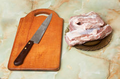 Meat, knife and board Royalty Free Stock Photography