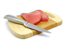 Meat and knife food on the board isolated Royalty Free Stock Images
