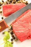 Meat, knife and pepper Royalty Free Stock Images