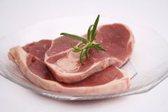 Meat of a lamb. Some fresh meat of a lamp with rosemary Royalty Free Stock Photo