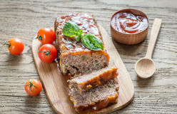 Meat loaf with barbecue sauce on the wooden board Royalty Free Stock Images