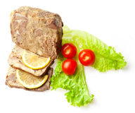 Meat loaf decorated with tomatoes, limon and salad Stock Images