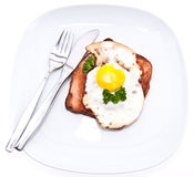Meat loaf with fried egg on top Stock Image