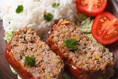 Meat loaf with rice and vegetables macro horizontal top view Royalty Free Stock Images