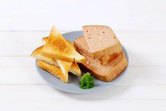 Meat loaf with toasts Stock Images
