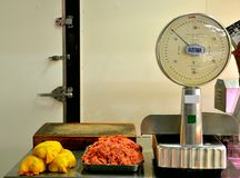 Meat market in Florence, Italy with old scales and raw meat Stock Photo