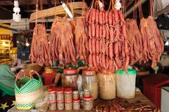 Meat market Cambodia. Sausage and fresh meat are sold by the butcher at the Siem Reap market in Cambodia Stock Photography