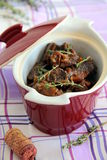 Meat meal. In burgundy pot on the table Royalty Free Stock Images