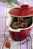 Meat meal. In burgundy pot on the table Royalty Free Stock Photography