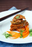 Meat meal. Prepared meat in Chinese on a white plate Royalty Free Stock Photography