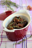 Meat meal. In burgundy pot on the table stock photo