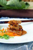 Meat meal. Prepared meat in Chinese on a white plate Royalty Free Stock Photos