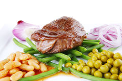 Meat medalion on beans Stock Photography