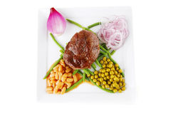Meat medalion on beans Royalty Free Stock Images
