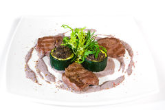 Meat medallions. Grilled Meat medallions on white plate Stock Images