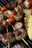 Meat mix with vegetable on grill Royalty Free Stock Photography