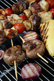 Meat mix with vegetable on grill Stock Photos