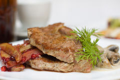 Meat, mushroom and cowberry sauce Royalty Free Stock Image