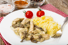Meat in mushroom sauce with mashed potatoes Stock Photo