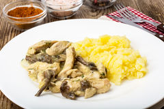 Meat in mushroom sauce with mashed potatoes Royalty Free Stock Photography