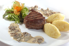 meat with mushroom sauce Stock Images
