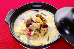 Meat and mushroom soup. A casserole of nutrient delicious soup cooked with meat, chicken, mushroom and vegetable stock photo