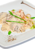 Meat with mushroom in white sauce Stock Photo