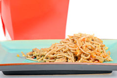 Meat, noodles and red take away container Stock Images
