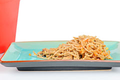 Meat, noodles and red take away container Stock Image