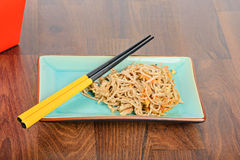 Meat and noodles in red take away container Stock Image