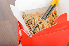 Meat and noodles in red take away container Royalty Free Stock Image