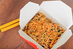 Meat and noodles in take away container Stock Photo