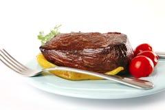 Meat och grönsaker på blue Fotografering för Bildbyråer
