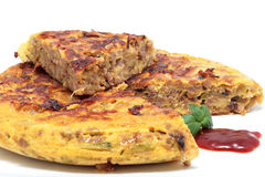 Meat omelet. Tortilla of minced meat with onion and zucchini isolated Stock Image