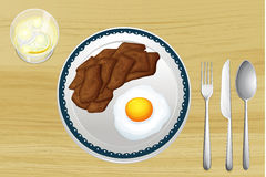 A meat and an omelet in a dish Royalty Free Stock Image