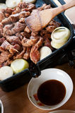 Meat onions cooking grill Stock Photography