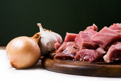 Meat with onions and garlic Stock Image