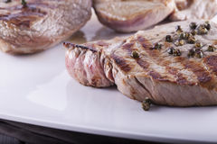 Meat over white plate Royalty Free Stock Image
