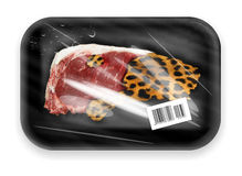 Meat packed in box. Wild cat fresh flash with fur packed in black package behind transparent plastic foil Royalty Free Stock Photos
