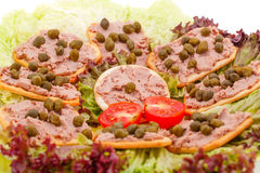Meat pate with capers on crackers Stock Photo